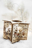 Wooden Christmas Candle Holder in the Snow Stock Photo
