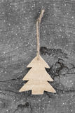 Wooden christmas carved tree - shabby style on a grey background Royalty Free Stock Images