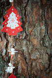 Wooden Christmas decorations on bark Stock Photography