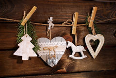 Wooden christmas decorations hanging on twine Stock Photo