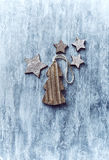 Wooden Christmas decorations on painted wood Royalty Free Stock Photo