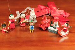 Wooden Christmas decorations. On red background Royalty Free Stock Photos