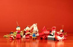 Wooden Christmas decorations. On red background Royalty Free Stock Photography