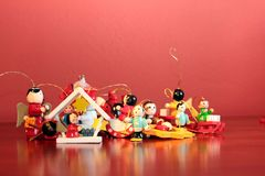 Wooden Christmas decorations. On red background Stock Photography