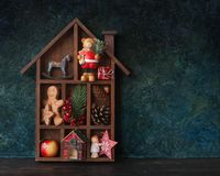 Wooden Christmas decorative house. With gifts, Christmas decoration and cookies, place for text Royalty Free Stock Photos