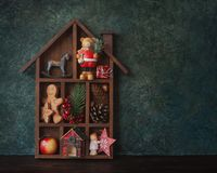 Wooden Christmas decorative house. With gifts, Christmas decoration and cookies, place for text Royalty Free Stock Photography
