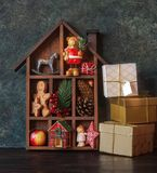 Wooden Christmas decorative house. With gifts, Christmas decoration and cookies stock images