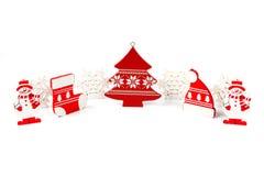 Wooden Christmas figurines snowmen snowflakes Christmas tree hat Stock Image