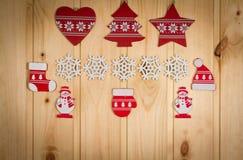 Wooden Christmas figurines snowmen snowflakes Christmas tree hat Stock Photos
