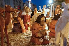 Wooden Christmas nativity scene in the square stock image