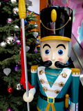 Wooden Christmas nutcracker. By Christmas tree Royalty Free Stock Images
