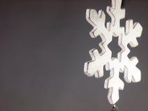 Wooden Christmas ornament. Big snowflake. Stock Image