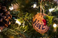 Wooden christmas ornament on a tree royalty free stock image