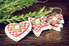 Wooden Christmas ornaments. Christmas ornaments on wooden background Stock Image