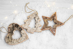 Wooden Christmas Ornaments in the Snow Stock Photo