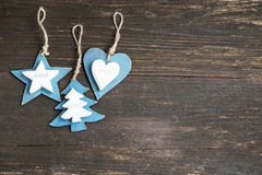 Wooden Christmas Ornaments for the Tree with Star,Heart and Fir Stock Photo