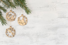 Wooden christmas pendants hanging on a white background stock images