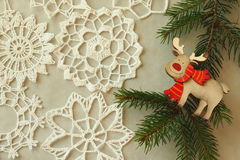Wooden christmas reindeer on a grey background Royalty Free Stock Image