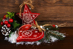 Wooden christmas star and heart decoration Stock Photos