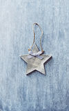 Wooden Christmas star on painted wood Royalty Free Stock Images