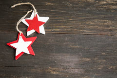 Wooden Christmas Stars Decoration in White and Red on Wooden Bac Stock Image