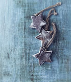 Wooden christmas stars on painted wood Royalty Free Stock Photo