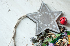 Wooden Christmas toy and spices on the table. Wooden star, dry mint, cardamom and cloves. Rustic Christmas background. Royalty Free Stock Photos