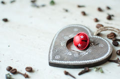 Wooden Christmas toy on the table. Heart, coffee beans and spices. Rustic Christmas background. Royalty Free Stock Image