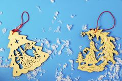 Wooden Christmas toys and snow on a blue background stock images