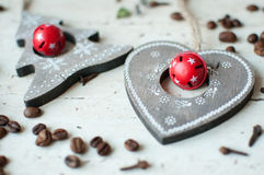 Wooden Christmas toys on the table. Tree, heart, coffee beans and spices. Rustic Christmas background. Stock Images