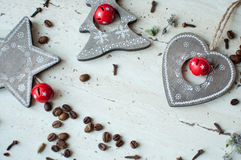 Wooden Christmas toys on the table. Tree, heart, star, coffee beans and spices. Rustic Christmas background. Stock Image