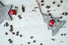 Wooden Christmas toys on the table. Tree, star, coffee beans and spices. Rustic Christmas background. Stock Photo