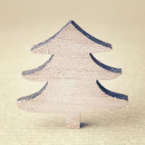 Wooden christmas tree on an antique vintage paper Royalty Free Stock Photography