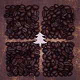 Wooden christmas tree on dark roasted coffee beans Royalty Free Stock Images