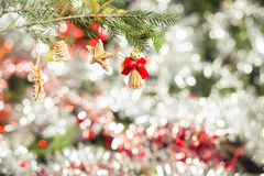 Wooden Christmas Tree Decorations. Wooden decorations on a Christmas tree branch Stock Photo