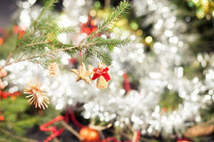 Wooden Christmas Tree Decorations. Wooden decorations on a Christmas tree branch Stock Images