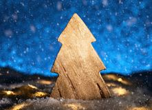Wooden Christmas tree in front of a blue background royalty free stock photos