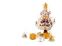 Wooden Christmas tree with gift boxes and bells. On white background Stock Photo