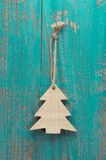 Wooden christmas tree on a old shabby board for a greeting card Stock Photography