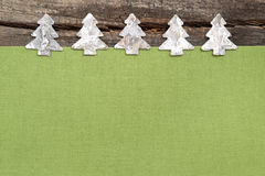 Wooden Christmas trees with green fabric on grey wooden backgrou Stock Photo