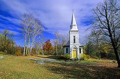 Wooden Church. A view of a wooden church surrounded by trees in the fall Royalty Free Stock Photos