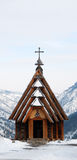Wooden Church. Small wooden Orthodox church on top of a mountain surrounded with snow Stock Photography