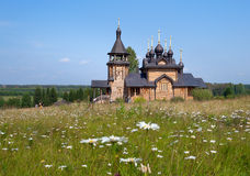 Wooden church of All Saints of Siberia on the Tura river. Royalty Free Stock Photography