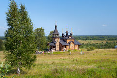 Wooden church of All Saints of Siberia on the Tura river. Royalty Free Stock Photos