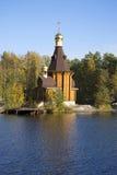 The wooden Church of the Apostle Andrew on Vuoksa gold autumn. Leningrad region Stock Photos