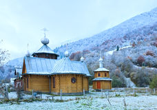 Wooden church and autumn mountain forest Royalty Free Stock Photography