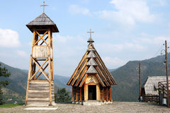 Wooden church and bell tower Stock Images