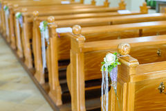 Wooden church bench with decoration Stock Photos