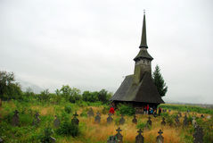 Wooden church and cemetery. Historic Wooden Church in Romania, cemetery Stock Image