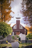 Wooden church in cemetery Stock Photography